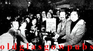 Group image of staff and customers at the Clan Bar MacDonald Hotel 1979