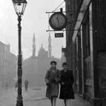 Image of the Clock Bar Bedford Street Gorbals with two ladies walking by