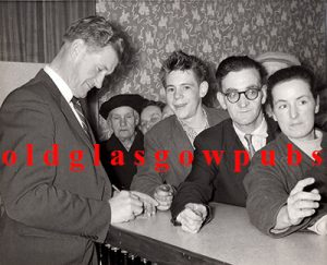 Image of Willie Woodburn Rangers F.C. at the opening of Deans Bar Off Sales 1960s