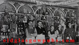 Interior image of the Dunrobin Bar with barmen 1947