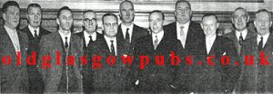 Large group of men with John Dougan, Springburn Road 1962