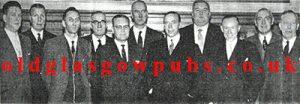 Large group of men with John Dougan, Springburn Road 1962