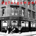 Image of the Possil Bar with children posing outside Saracen Street corner of Mansion Street