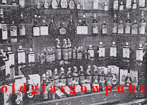 Image of Wypers Bar Renfield Street window with lots of Bottles for sale 1956
