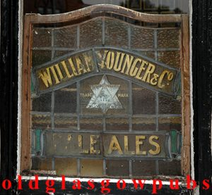 Image of one of the leaded advertising windows of the Camphill Vaults. 2005