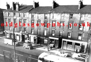 Exterior view of Springburn Road with Dougan's Bar on the left 1960s